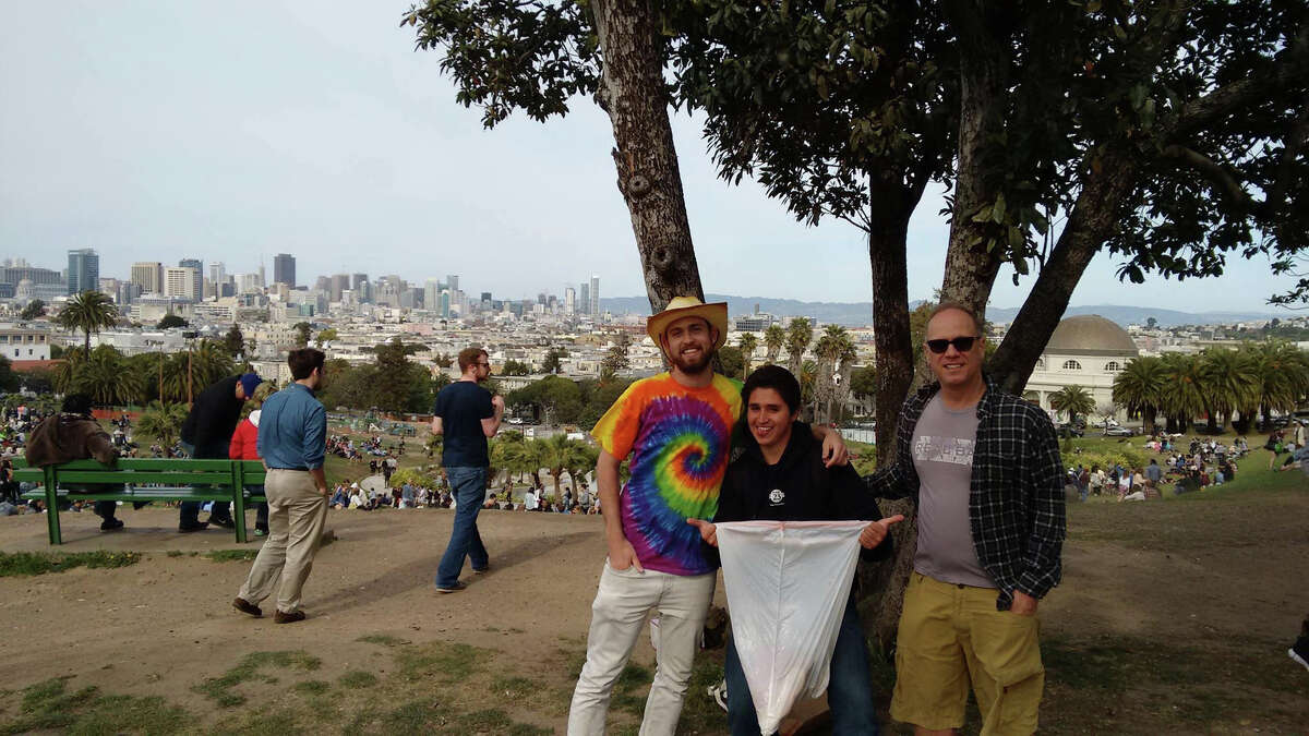 Enemies of litter: cleanup organizer Andrew Rogers (left), an unidentified volunteer and Gus Preston, a Dolores Park neighbor who joined the effort Saturday for three hours.