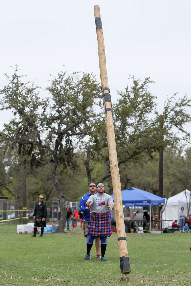 Scott Hutchison from Austin watches his caber bounce off the ground in the amateur competition during the annual Highland Games and Celtic Music Festival last year. This year's two-day event celebrating Celtic music, Scottish heavy athletic competitions, living history, food and drink will be Saturday and Sunday, April 11-12. Photo: Marvin Pfeiffer / Northwest Light / Express-News 2014