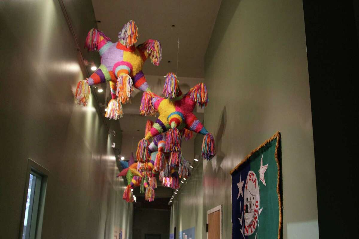 """The """"Jewels of the Court"""" Fiesta exhibit at the Witte Museum showcases a number of different aspects surrounding Fiesta, including the Battle of Flowers Parade and the high fashion seen in the Fiesta court."""