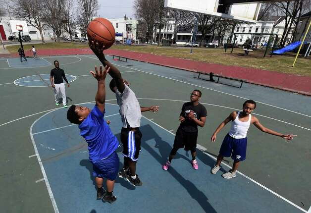 Tysheem Morris, 19, goes high for the ball as Manny Sturdivant, 19, tries to make the steal during a game of basketball at the Madison Avenue Playground on Ontario Street Monday afternoon, April 6, 2015, in Albany, N.Y.   (Skip Dickstein/Times Union) Photo: SKIP DICKSTEIN