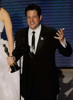 """HOLLYWOOD - MARCH 07:  Composer Michael Giacchino accepts Best Original Score award for """"Up"""" onstage during the 82nd Annual Academy Awards held at Kodak Theatre on March 7, 2010 in Hollywood, California.  (Photo by Kevin Winter/Getty Images) *** Local Caption *** Michael Giacchino Photo: Kevin Winter, Getty Images / 2010 Getty Images"""