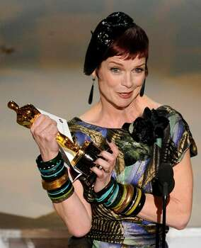 Sandy Powell accepts the Oscar for best achievement in costume design for ?The Young Victoria? at the 82nd Academy Awards Sunday, March 7, 2010, in the Hollywood section of Los Angeles. (AP Photo/Mark J. Terrill) Photo: Mark J. Terrill, ASSOCIATED PRESS / AP2010