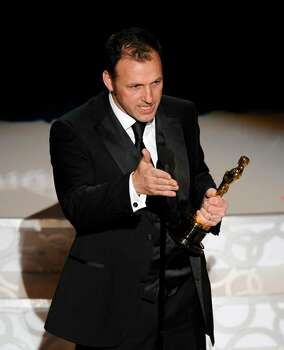 Mauro Fiore accepts the Oscar for best achievement in cinematography for ?Avatar? at the 82nd Academy Awards Sunday, March 7, 2010, in the Hollywood section of Los Angeles. (AP Photo/Mark J. Terrill) Photo: Mark J. Terrill, ASSOCIATED PRESS / AP2010