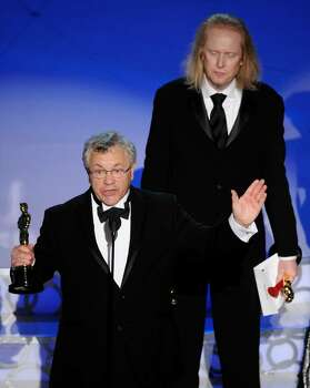 """Ray Beckett accept the Oscar for best achievement in sound mixing for """"The Hurt Locker""""at the 82nd Academy Awards Sunday, March 7, 2010, in the Hollywood section of Los Angeles. In background looking on is Paul N.J. Ottosson. (AP Photo/Mark J. Terrill) Photo: Mark J. Terrill, AP / AP"""