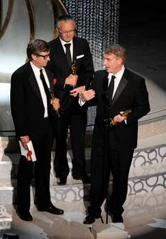 From left, Rick Carter, Kim Sinclair and Robert Stromberg  accept the Oscar for best achievement in art direction for ?Avatar? at the 82nd Academy Awards Sunday, March 7, 2010, in the Hollywood section of Los Angeles. (AP Photo/Mark J. Terrill) Photo: Mark J. Terrill, ASSOCIATED PRESS / AP2010