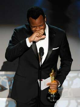 """Geoffrey Fletcher accepts the Oscar for best adapted screenplay for """"Precious: Based on the Novel 'Push' by Sapphire"""" at the 82nd Academy Awards Sunday, March 7, 2010, in the Hollywood section of Los Angeles. (AP Photo/Mark J. Terrill) Photo: Mark J. Terrill, ASSOCIATED PRESS / AP2010"""