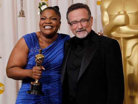 With presenter Robin Williams, Mo'Nique poses backstage with the Oscar for best performance by an actress in a supporting role for ?Precious: Based on the Novel 'Push' by Sapphire? at the 82nd Academy Awards Sunday, March 7, 2010, in the Hollywood section of Los Angeles. (AP Photo/Matt Sayles) ** EMBARGOED AT THE REQUEST OF THE ACADEMY OF MOTION PICTURE ARTS & SCIENCES FOR USE UPON CONCLUSION OF THE ACADEMY AWARDS TELECAST ** Photo: Matt Sayles, ASSOCIATED PRESS / AP2010
