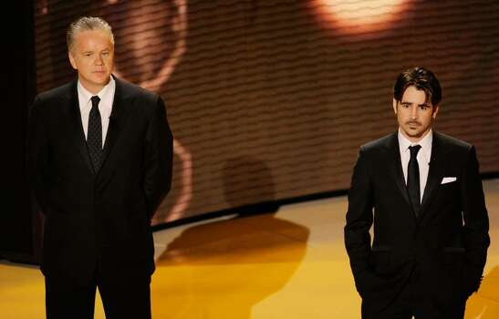 HOLLYWOOD - MARCH 07:  Actors (L-R) Tim Robbins and Colin Farrell present onstage during the 82nd Annual Academy Awards held at Kodak Theatre on March 7, 2010 in Hollywood, California.  (Photo by Kevin Winter/Getty Images) *** Local Caption *** Tim Robbins;Colin Farrell Photo: Kevin Winter, Getty Images / 2010 Getty Images