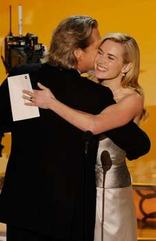 """HOLLYWOOD - MARCH 07:  Actor Jeff Bridges accepts Best Actor award for """"Crazy Heart"""" from presenter Kate Winslet onstage during the 82nd Annual Academy Awards held at Kodak Theatre on March 7, 2010 in Hollywood, California.  (Photo by Kevin Winter/Getty Images) *** Local Caption *** Jeff Bridges;Kate Winslet Photo: Kevin Winter, Getty Images / 2010 Getty Images"""