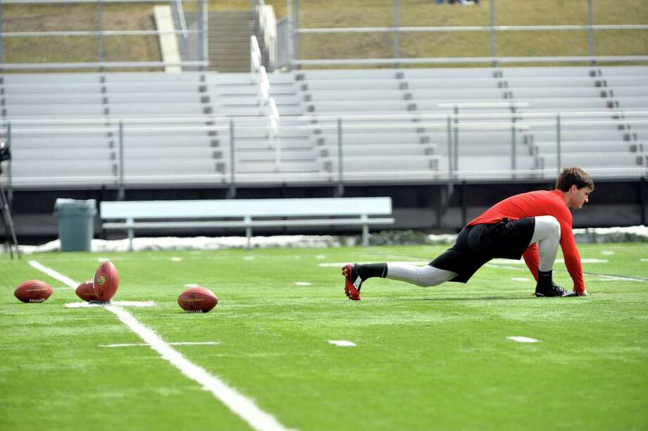 RPI football kicker, Andrew Franks, stretches out before attempting a kick as he took part in a tryout in front of three NFL scouts on Monday, April 6, 2015, at RPI in Troy, N.Y.   (Paul Buckowski / Times Union) Photo: PAUL BUCKOWSKI / 00031320A