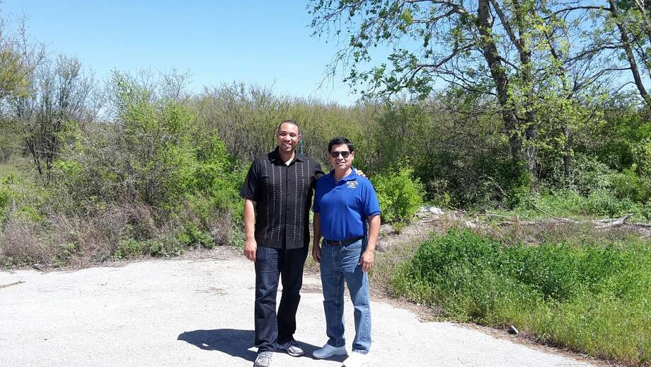 Bexar County Precinct 4 Commissioner Tommy Calvert (left) and Converse Mayor Al Suarez stand on the cusp of a 52-acre tract the county plans to develop in Converse along Loop 1604. Photo: Courtesy Photo