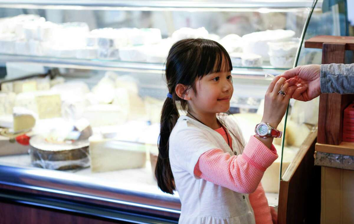 Kate Kelly, 8, of Grass Valley takes a sample of cheese from her mom, Stacy, on Thursday, April 2, 2015 at Freestone Artisan Cheese in Sebastopol, Calif.