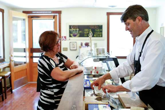 Omar Mueller, owner of Freestone Artisan Cheese, chats with customer Julie Davis of Sebastopol on Thursday, April 2, 2015 in Sebastopol, Calif.
