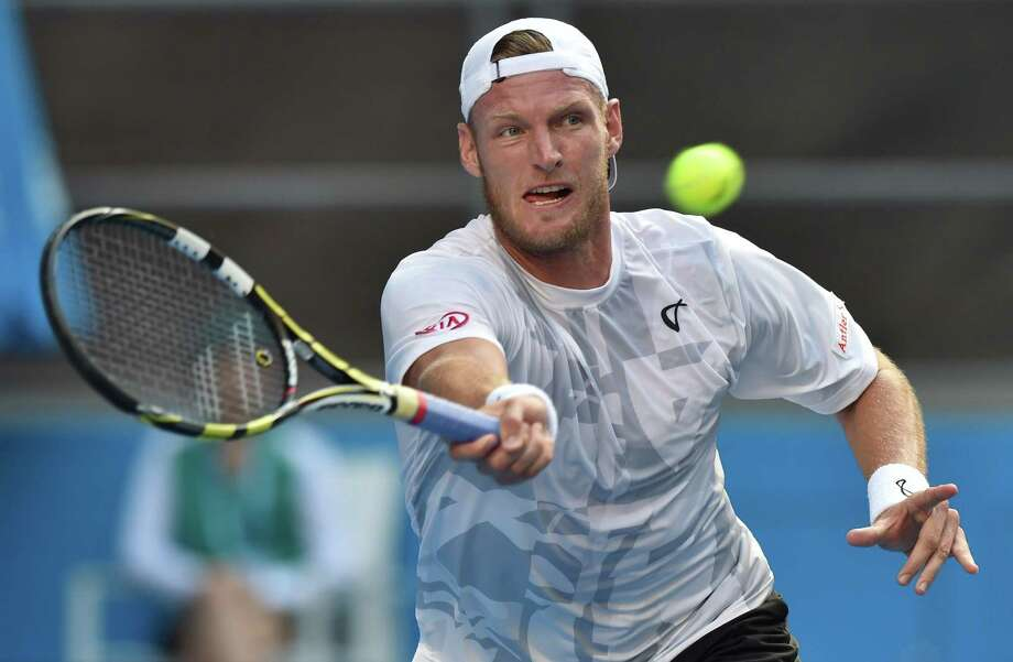 Australia's Sam Groth plays a shot during his men's singles match against Australia's Bernard Tomic on day five of the 2015 Australian Open tennis tournament in Melbourne on January 23, 2015. AFP PHOTO / PAUL CROCK-- IMAGE RESTRICTED TO EDITORIAL USE - STRICTLY NO COMMERCIAL USEPAUL CROCK/AFP/Getty Images Photo: PAUL CROCK, Stringer / AFP