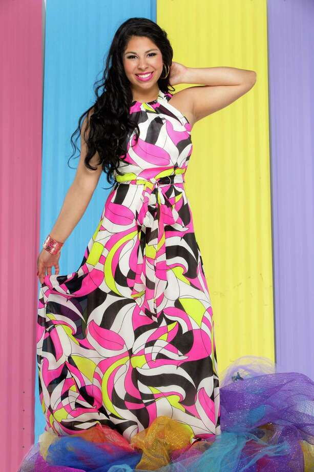 Miss Fiesta 2015 Alixzandra Peña wears a maxi by Muse, $188 and double hoop earrings, $275, both Julian Gold; Betsey Johnson cuff, $45, Dillard's North Star Mall. Photo: William Luther / San Antonio Express-News / © 2015 William Luther
