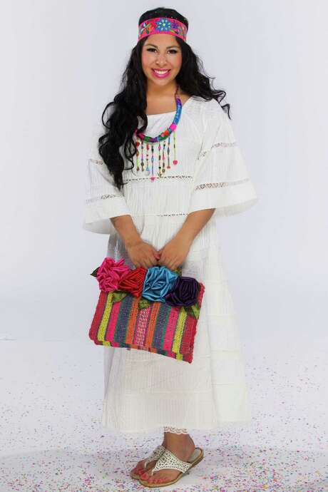 Miss Fiesta 2015 Alixzandra Pe–a poses in the Express-News photo studio Monday March 30, 2015. She is wearing: Tachi Castillo white dress, $140, headband, $21, statement necklace, $75, embroidered handbag, $82, all Nativa. Shoes belong o model. Photo: William Luther / San Antonio Express-News / © 2015 William Luther