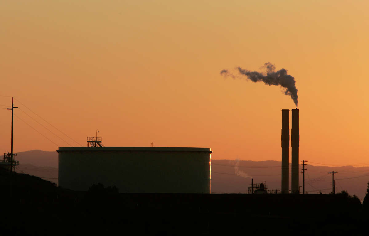 The Conoco Oil Refinery, in Rodeo, Calif. is seen at sunset, in file photo taken Friday, Sept. 22, 2006. ConocoPhillips owns this refinery in Rodeo