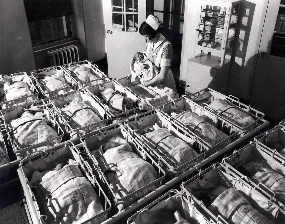 In this 1930, file photo, a nurse holds a baby in the nursery of the Pennsylvania Hospital in Philadelphia. Every year, slightly more boy babies than girl babies are born. But back when sperm meets egg, the two sexes are conceived in equal numbers, according to a new study released on Monday. Photo: Associated Press / HONS