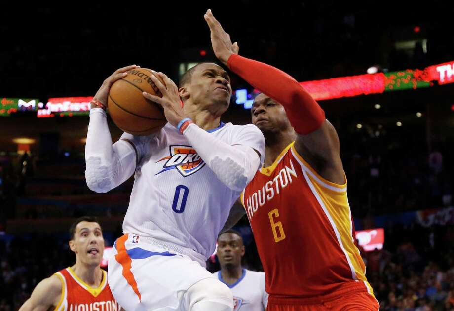Oklahoma City Thunder guard Russell Westbrook goes to the basket in front of Houston Rockets forward Terrence Jones on April 5, 2015. Houston won 115-112. Photo: Sue Ogrocki /Associated Press / AP