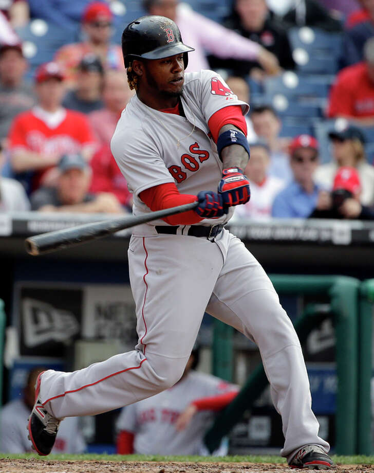 Boston Red Sox's Hanley Ramirez hits a grand slam during the ninth inning of an opening day baseball game against Philadelphia Phillies on Monday, April 6, 2015, in Philadelphia. Red Sox won 8-0. (AP Photo/Matt Rourke) Photo: Matt Rourke / Associated Press / AP