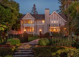 Gables, a covered porch and a winding walkway provide dramatic curb appeal.
