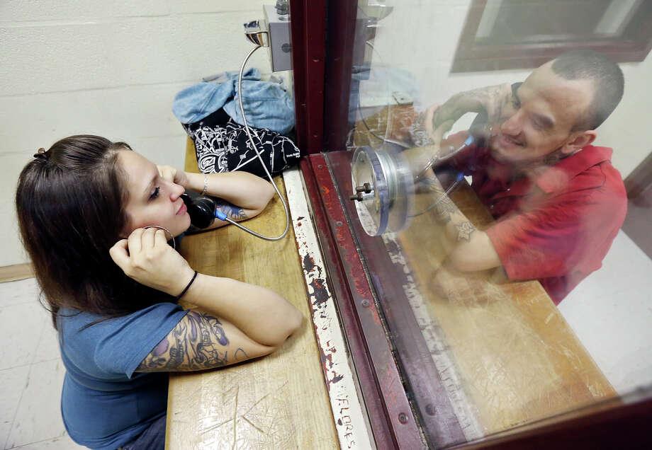 Rachael Borrego, 27, (left) visits her boyfriend Bryce Gamez, 26, Monday April 6, 2015 at the Bexar County Jail. Photo: Edward A. Ornelas, Staff / San Antonio Express-News / © 2015 San Antonio Express-News