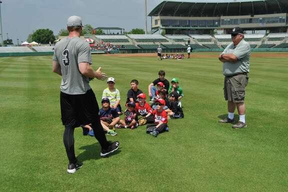 Kyle Gaedele, of the San Antonio Missions baseball team, talks to members of the team's Kids Club.