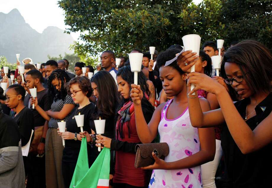 Students attends a vigil for people killed in an attack on a college by Islamic militants in Garissa, Kenya, at the University of Cape Town, in Cape Town, South Africa, Monday, April 6, 2015. Kenya launched airstrikes against Islamic militants in Somalia following an extremist attack on a Kenyan college that killed 148 people, a military spokesman said Monday. (AP Photo/Schalk van Zuydam) Photo: Schalk Van Zuydam /Associated Press / AP