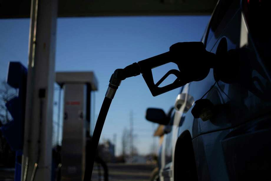 The gasoline flowing into U.S. vehicles is more than $1 cheaper than a year ago, and predictions are that the price relief will continue into the summer travel season.. Photographer: Luke Sharrett/Bloomberg Photo: Luke Sharrett / © 2014 Bloomberg Finance LP