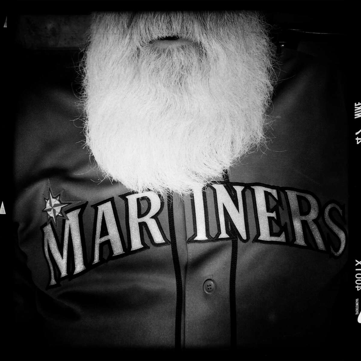 Jim Hunt, of Renton, Wash., poses for a portrait in his jersey during Seattle Mariners Opening Day Monday, April 6, 2015, at Safeco Field in Seattle, Washington. All images shot on an iPhone 5S and processed in-phone with the Hipstamatic application.