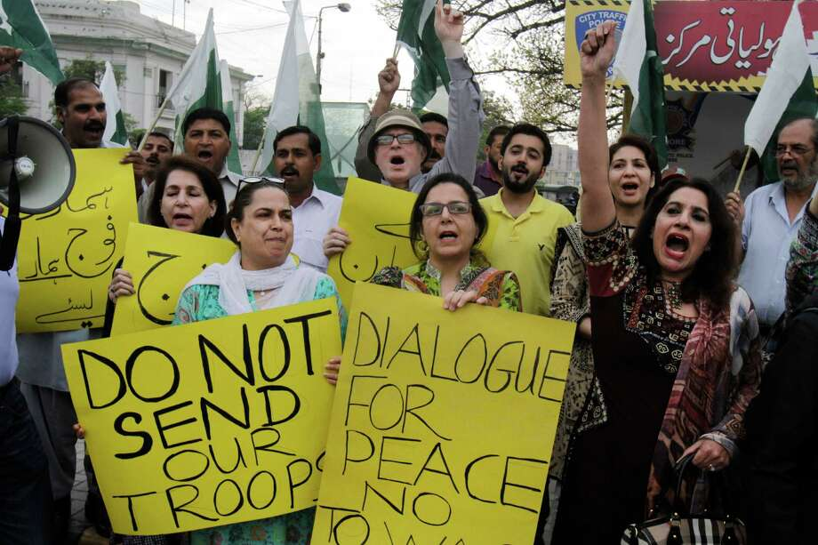Members of Pakistan's civil society chant slogans against the Saudi-led coalition targeting Shiite rebels in Yemen, during a demonstration, in Lahore, Pakistan, Monday, April 6, 2015. A Saudi-led coalition targeting Shiite rebels in Yemen has asked Pakistan to contribute soldiers, Pakistan's defense minister said Monday, raising the possibility of a ground offensive in the country. (AP Photo/K.M. Chaudary) ORG XMIT: ISL101 Photo: K.M. Chaudary / AP