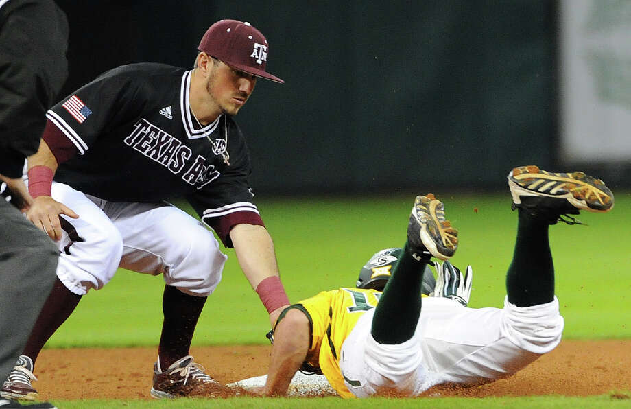 Baylor center fielder Logan Brown is tagged out at second on a pick off by Texas A&M shortstop Blake Allemand, a former Boerne Champion star, during the first inning on March 8, 2015, at Minute Maid Park in Houston. Photo: Eric Christian Smith /For The Houston Chronicle / 2015 Eric Christian Smith