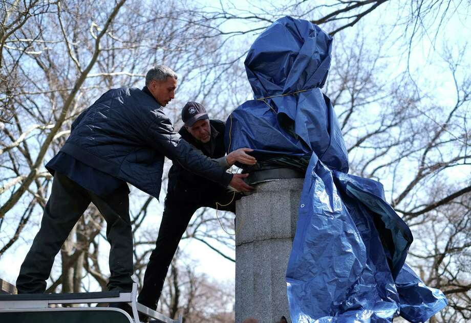 TOPSHOTS New York City Department of Parks and Recreation employees take down a statue of former National Security Agency (NSA) contractor Edward Snowden at the Fort Greene Park in Brooklyn, New York, on April 6, 2016.  A group of artists on Monday installed a bust of fugitive US intelligence analyst Edward Snowden on a war memorial in a New York park, though authorities quickly removed the illicit statue. Snowden, 31, a former contractor at the US National Security Agency, has lived in exile in Russia since 2013 after revealing mass spying programs by the United States and its allies.  AFP PHOTO/ JEWEL SAMADJEWEL SAMAD/AFP/Getty Images ORG XMIT: Artists p Photo: JEWEL SAMAD / AFP