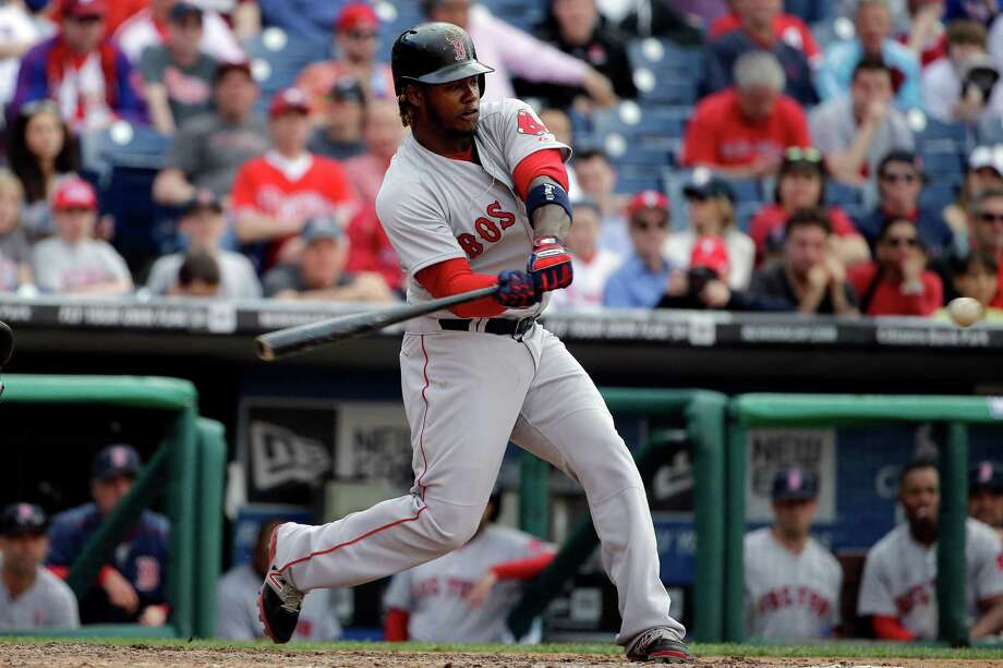 Boston Red Sox's Hanley Ramirez hits a grand slam during the ninth inning of an opening day baseball game against Philadelphia Phillies on Monday, April 6, 2015, in Philadelphia. Red Sox won 8-0. (AP Photo/Matt Rourke) ORG XMIT: PAMR115 Photo: Matt Rourke / AP