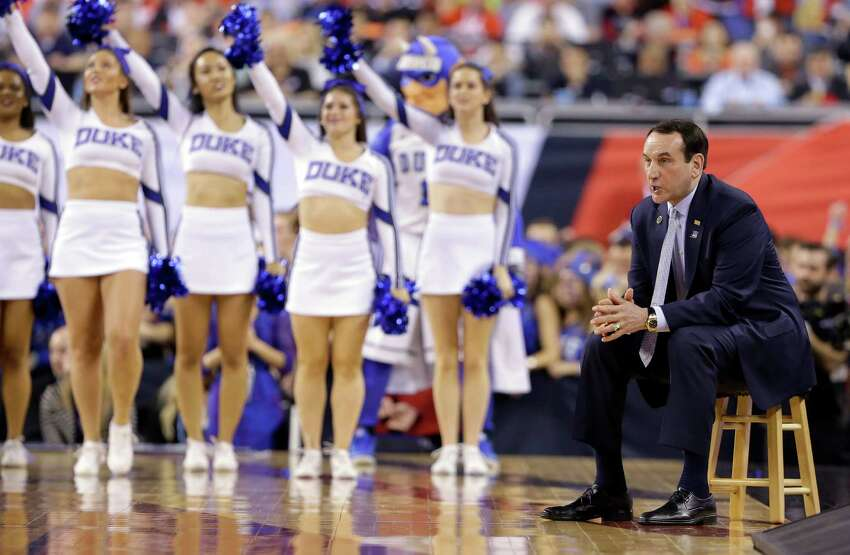 Duke head coach Mike Krzyzewski looks on from the bench during the first half of the NCAA Final Four college basketball tournament championship game against Wisconsin Monday, April 6, 2015, in Indianapolis. (AP Photo/Michael Conroy)