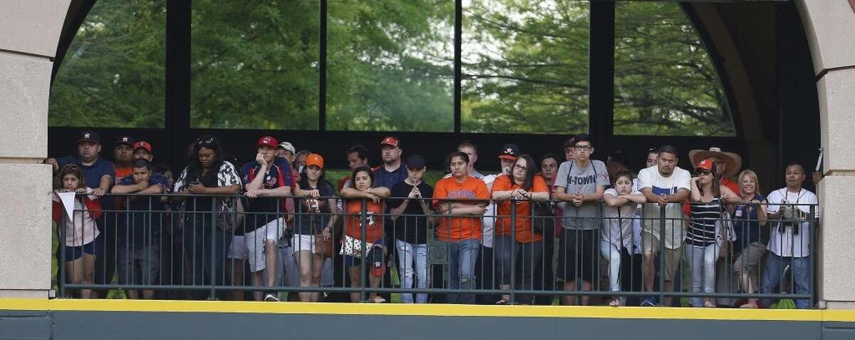 Houston Astros fans line the outfield fence during the second inning of the 2015 season opener against Cleveland at Minute Maid Park.
