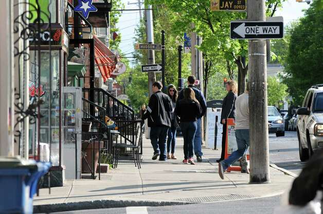 People walking down Lark Street sidewalks in Albany. Walkable neighborhoods are an economic opportunity for Albany, columnist Chris Churchill argues. (Will Waldron / Times Union) Photo: Will Waldron / 00022396A