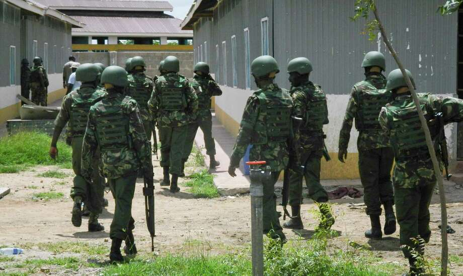 Soldiers from the Kenya Defence Forces (KDF) patrol inside the Garissa University College compound that was the scene of last week's attack by al-Shabab gunmen, in Garissa, Kenya, Monday, April 6, 2015. Kenya launched air strikes against al-Shabab Islamic militants in Somalia on Sunday afternoon and early Monday morning, following the extremist attack on a Kenyan college that killed 148 people, a military spokesman said. (AP Photo) ORG XMIT: NAI104 Photo: STR / AP