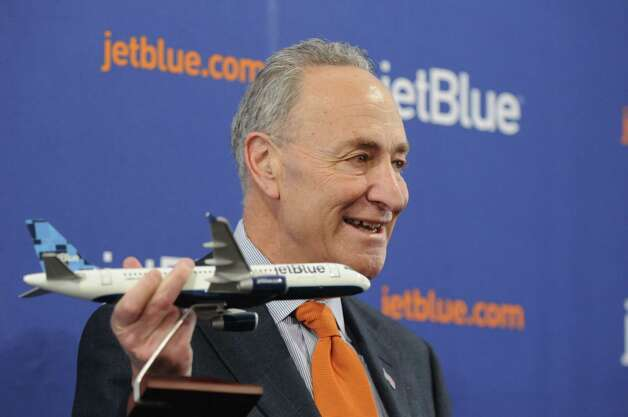 Sen. Charles Schumer announces the start the of JetBlue service to Florida from Albany Monday afternoon, April 6, 2015, at Albany International Airport in Albany, N.Y. The discount airline will initially offer nonstop flights to Orlando and Fort Lauderdale starting on December 10, 2015. (Will Waldron/Times Union) Photo: WW / 00031322A