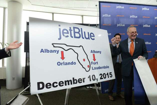 Sen. Charles Schumer, right, celebrates after announcing the start the of JetBlue service to Florida from Albany Monday afternoon, April 6, 2015, at Albany International Airport in Colonie, N.Y. The discount airline will initially offer nonstop flights to Orlando and Fort Lauderdale starting on December 10, 2015. (Will Waldron/Times Union) Photo: WW / 00031322A
