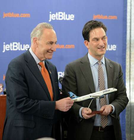 Sen. Charles Schumer, left, and Jeffrey Goodell, vice president government affairs for JetBlue, right, pose for a photo after announcing the start the of JetBlue service to Florida from Albany Monday afternoon, April 6, 2015, at Albany International Airport in Albany, N.Y. The discount airline will initially offer nonstop flights to Orlando and Fort Lauderdale starting on December 10, 2015. (Will Waldron/Times Union) Photo: WW / 00031322A