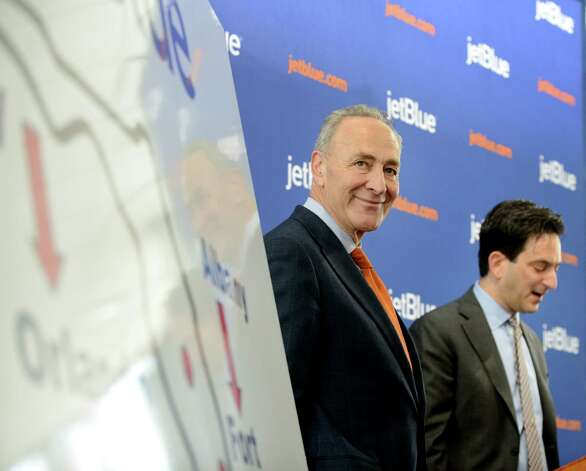 Sen. Charles Schumer, left, and Jeffrey Goodell, vice president government affairs for JetBlue, right, announce the start the of JetBlue service to Florida from Albany Monday afternoon, April 6, 2015, at Albany International Airport in Albany, N.Y. The discount airline will initially offer nonstop flights to Orlando and Fort Lauderdale starting on December 10, 2015. (Will Waldron/Times Union) Photo: WW / 00031322A