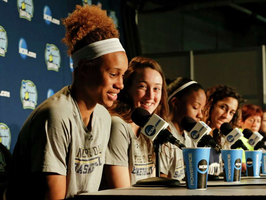 Notre Dame's Brianna Turner, left, answers a question, as teammates, from second left, Michaela Mabrey, Lindsay Allen, Taya Reimer, Jewell Loyd and head coach Muffet McGraw listen, during a news conference at the NCAA Women's Final Four college basketball tournament, Monday, April 6, 2015, in Tampa, Fla. Notre Dame will play Connecticut on Tuesday. (AP Photo/John Raoux) ORG XMIT: FLJR103 Photo: John Raoux / AP