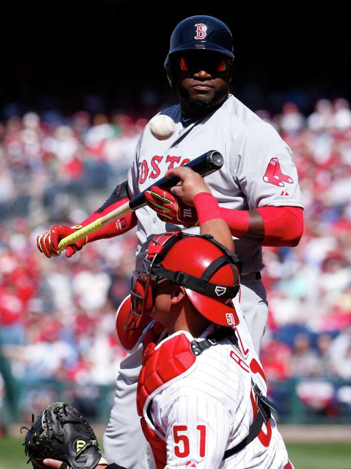 Boston Red Sox designated hitter David Ortiz, top, looks back after striking out as Philadelphia Phillies catcher Carlos Ruiz, bottom, throws the ball back to the pitcher during the first inning of an opening day baseball game, Monday, April 6, 2015, in Philadelphia. (AP Photo/Chris Szagola) ORG XMIT: PACS108 Photo: Chris Szagola / FR170982 AP