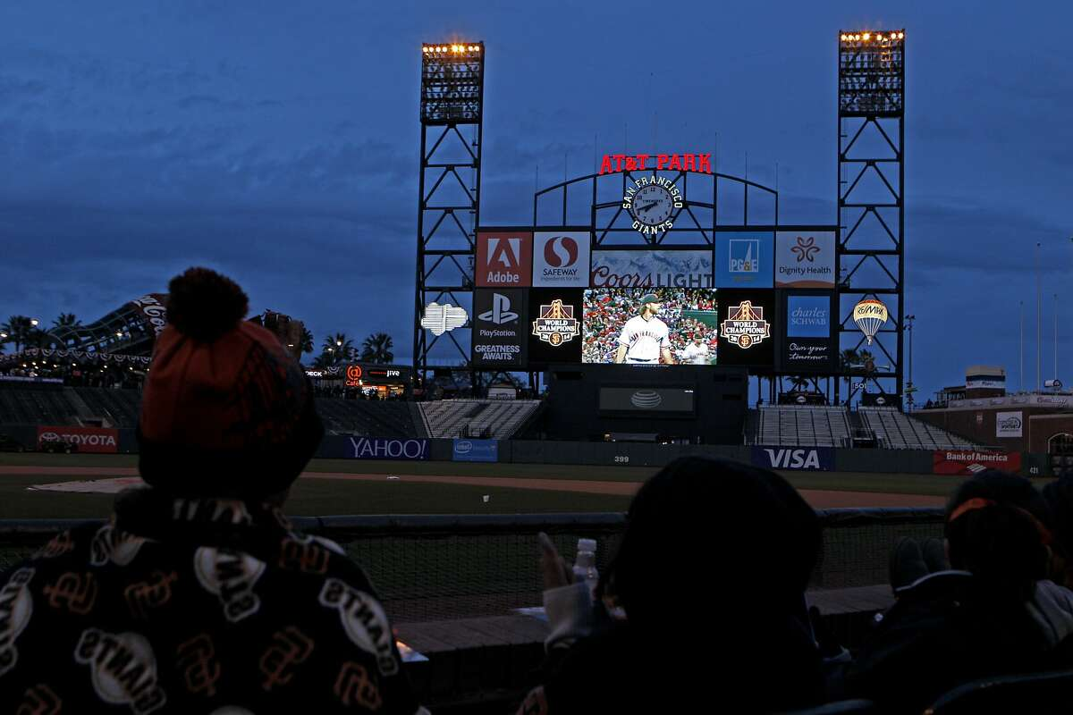 S.F. Giants fans watch the MLB baseball game between the San Francisco Giants and the Arizona Diamondbacks at AT&T Park's scoreboard, Monday, April 6, 2015, in San Francisco, Calif. The ballpark hosted a free viewing party for the season opener which was played at Chase Field in Phoenix.