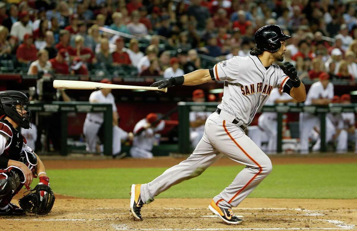 PHOENIX, AZ - APRIL 06: Angel Pagan #16 of the San Francisco Giants hits a RBI single against the Arizona Diamondbacks during the third inning of the Opening Day MLB game at Chase Field on April 6, 2015 in Phoenix, Arizona. (Photo by Christian Petersen/Getty Images)