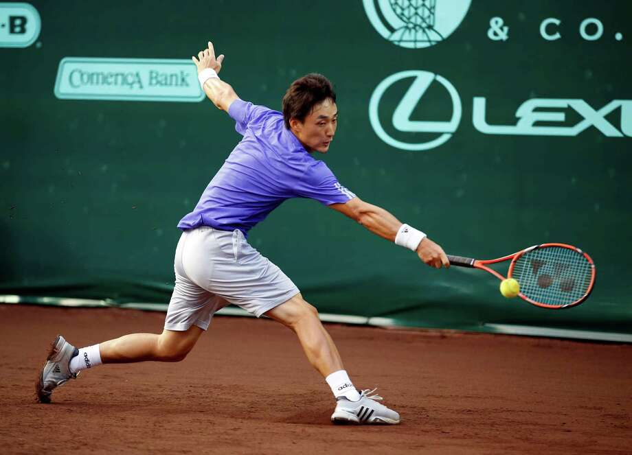 Go Soeda stretches to return a shot to Lleyton Hewitt on Monday during the U.S. Men's Clay Court Championship. Soeda came back to beat Hewitt in three sets. Photo: Craig Hartley, Freelance / Copyright: Craig H. Hartley