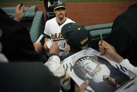 Billy Burns (1) signs autographs before the Oakland Athletics played the Texas Rangers at O.Co Coliseum on Monday, April 6, 2015, in Oakland, Calif.
