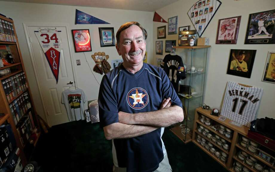 Richard Brinlee relaxes in his Deer Park home's baseball room. It was converted from a bedroom. Photo: Melissa Phillip, Staff / © 2015  Houston Chronicle