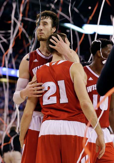 Wisconsin's Frank Kaminsky and Josh Gasser console each other after the Badgers' bid came up short Monday night. Photo: Michael Conroy, STF / AP